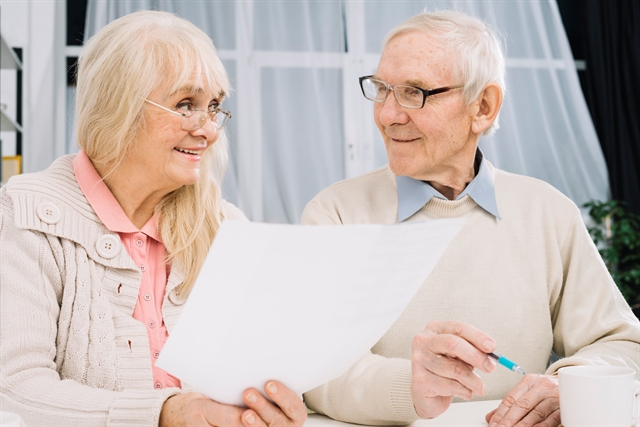 Senior couple planning and researching for assisted living