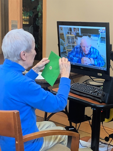 Male and female senior living community resident engage in a video call to stay connected during the coronavirus pandemic