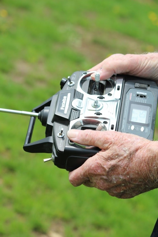 Chuck Hocking uses hand-eye coordination to fly his RC planes using a handheld controller