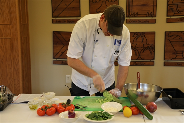 Displaying fresh produce on a table at a healthy cooking demonstration