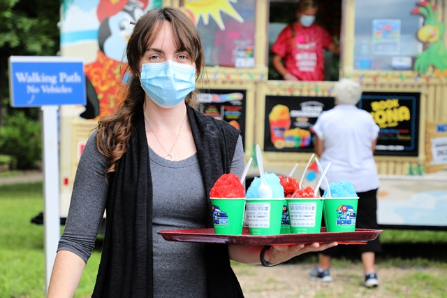 female staff member serving Kona Ice as appreciation to healthcare workers and senior living community residents