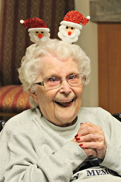 Happy resident at Three Pillars, smiling in the Christmas spirit