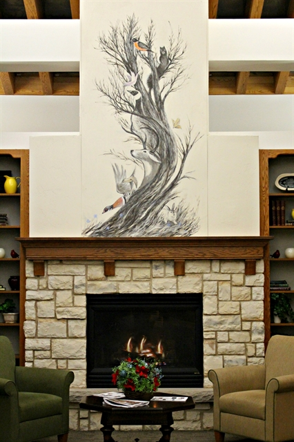 Martin Murk's artwork above the fireplace in the entrance of Three Pillars Senior Living Communities' Village on the Square Independent Living senior apartments