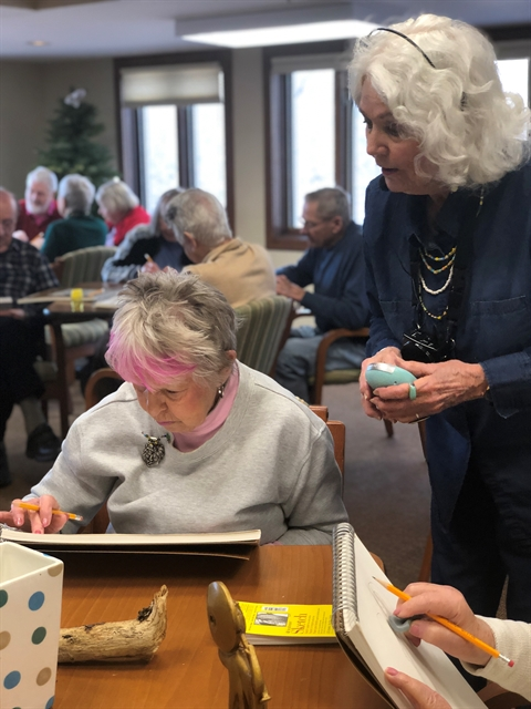 Independent living residents volunteer to help share their skills in a drawing class