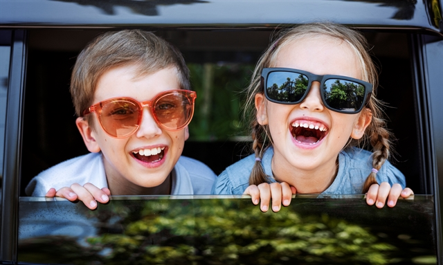 Boy and Girl, Grandchildren in Car Laughing, Looking out the Window, Ready for a Roadtrip