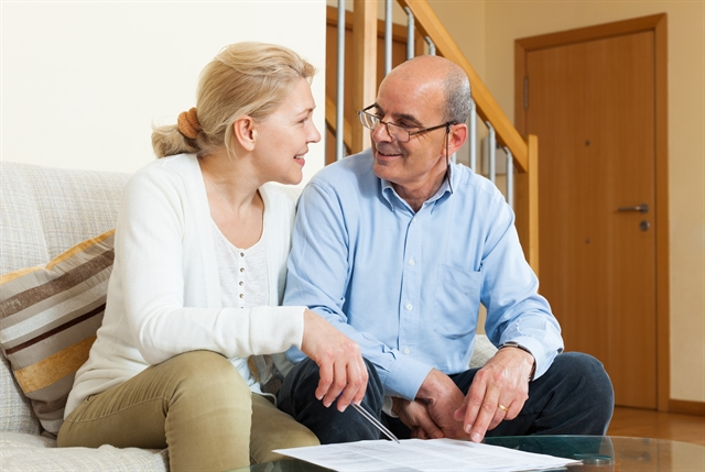 Older couple talking about finances with family