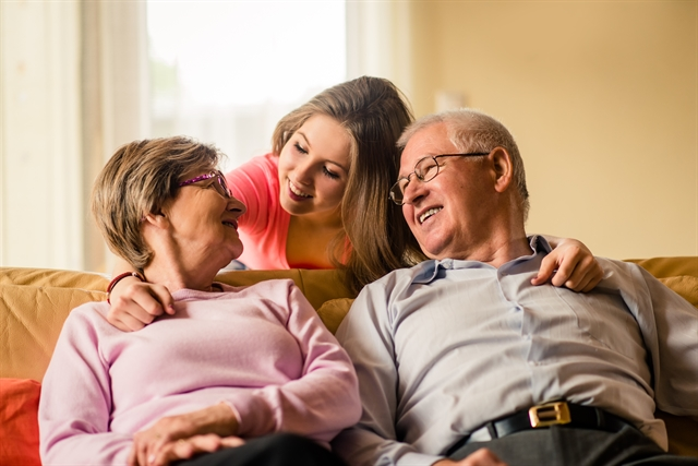 Daughter talking to older adult parents about moving to assisted living