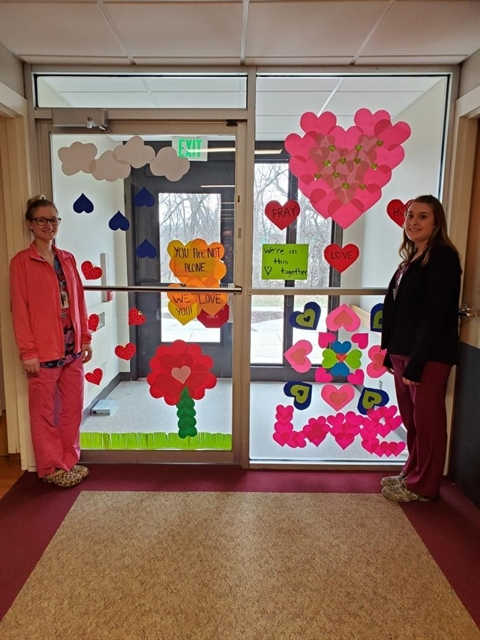 Three Pillars' Certified Nursing Assistants embrace teamwork, whether they're decorating windows or caring for residents.