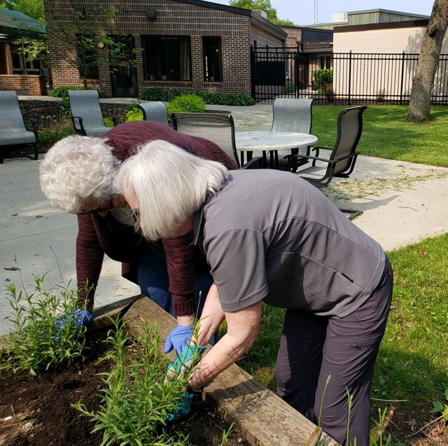 Female residents gardening at a senior community