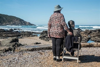 Older couple in retirement on beach