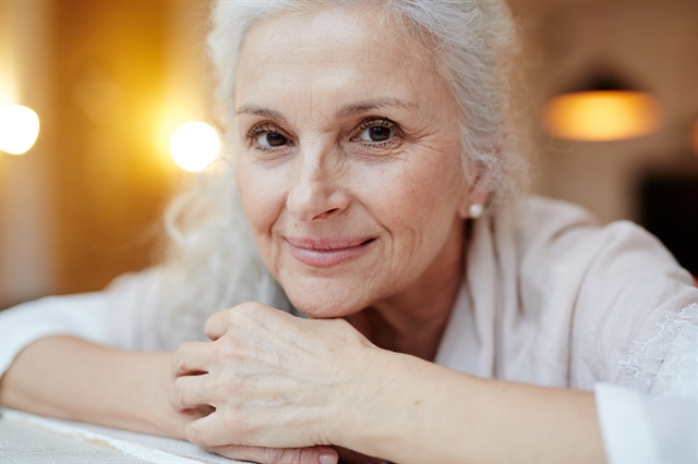 Older adult woman with soft smile